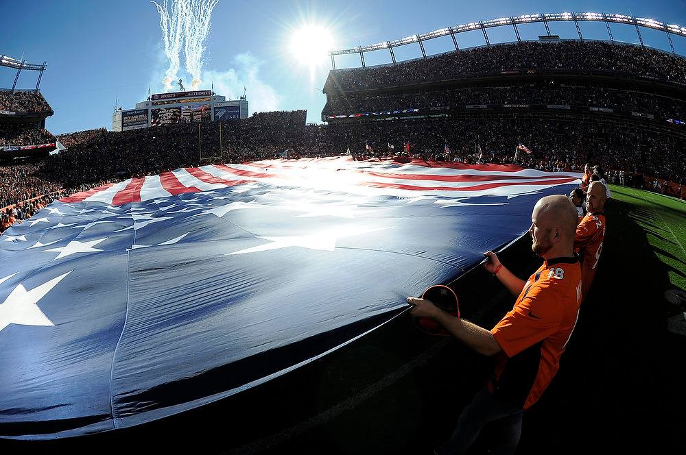 . The American flag is stretched out on the field prior to the game.  The Denver Broncos vs The Tampa Bay Buccaneers at Sports Authority Field Sunday December 2, 2012. John Leyba, The Denver Post