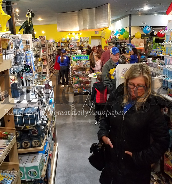 11/11 Shoppers tried out some of the hands-on toys that were left out for their use. PHOTO BY ERIC FREEHLING
