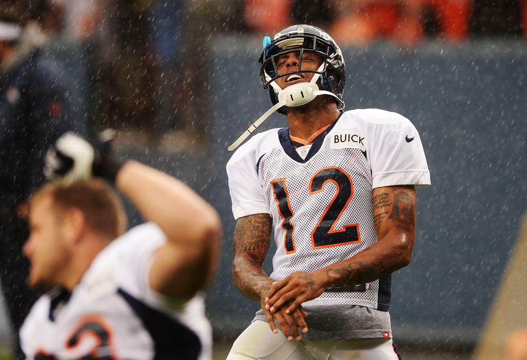 . DENVER, CO. - August 03: Andre Caldwell (12) of Denver Broncos is warming up for the summer scrimmage at Sports Authority Field at Mile High. Denver, Colorado. August 03, 2013. (Photo By Hyoung Chang/The Denver Post)