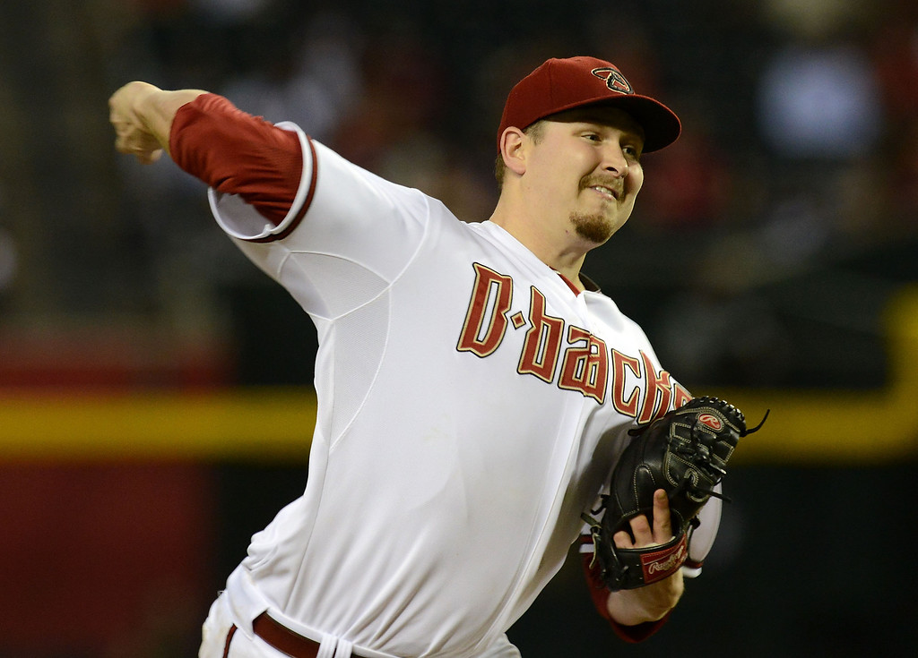 . PHOENIX, AZ - SEPTEMBER 16:  Trevor Cahill #35 of the Arizona Diamondbacks delivers a pitch against the Los Angeles Dodgers at Chase Field on September 16, 2013 in Phoenix, Arizona.  (Photo by Norm Hall/Getty Images)