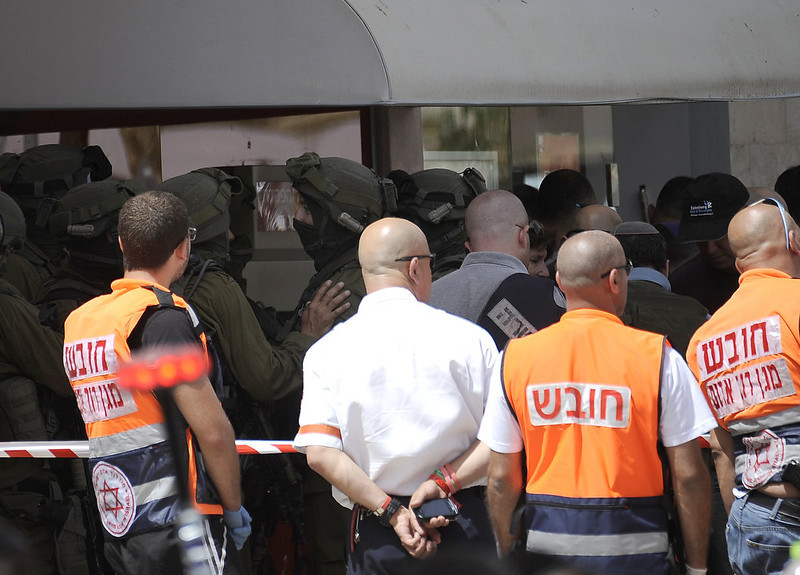 . Israeli security gather outside following a bank robbery that escalated into a hostage situation in the Israeli city of Beersheva, on May 20, 2013. Four people were killed and three others wounded in a botched bank heist in southern Israel which ended when a robber who had held a hostage shot himself dead, police said.  DAVID BUIMOVITCH/AFP/Getty Images