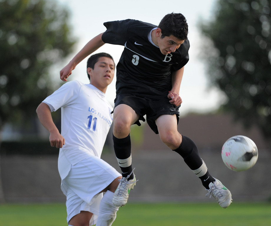 . 02-15-2012--(LANG Staff Photo by Sean Hiller)- Los Alamitos beat Buena 4-1 in the first round of the Division 1 boys soccer playoffs Friday at Laurel School in Los Alamitos. Ozvaldo Yanez (11) battles Buena\'s Luis Zamora (3).
