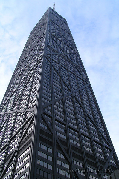 This is the John Hancock Center.  100 story building, 344m tall, is the third heighest in Chicago, and fourth in the US.