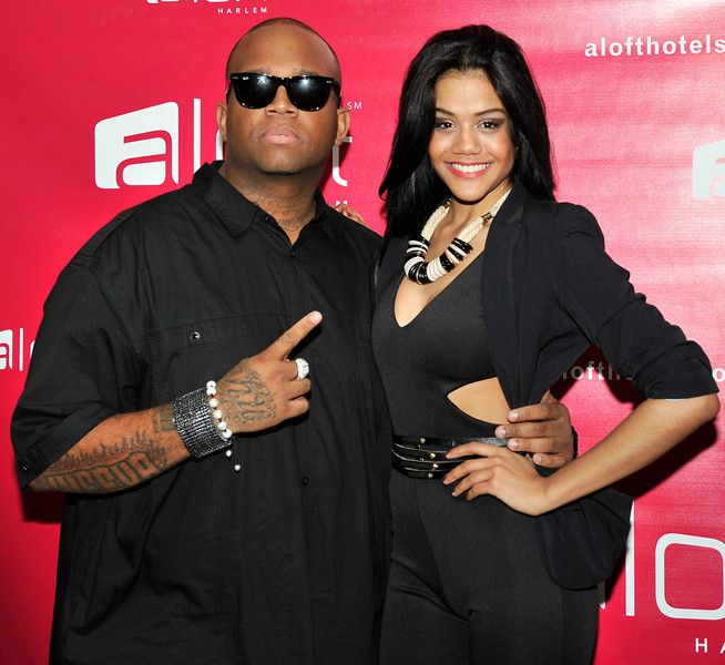 21 April 2012-New York, NY- Rapper HiFeva with actress Melanie, on red carpet, at Fashion Avenue News Magazine launch party at the Aloft Harlem Hotel. Photo Credit: Duncan Williams/Sipa USA