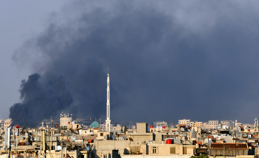 . In this citizen journalist image, smoke billows over Damascus, Syria, Wednesday, July 18, 2012. A bomb ripped through a high-level security meeting Wednesday in Damascus, killing three top regime officials ó including President Bashar Assad\'s brother-in-law ó in the harshest blow to Syria\'s ruling family dynasty and the rebels\' boldest attack in the country\'s civil war. Syrian state-run TV said the blast came during a meeting of Cabinet ministers and senior security officials in Damascus, which has seen four straight days of clashes between rebels and government troops. (AP Photo)
