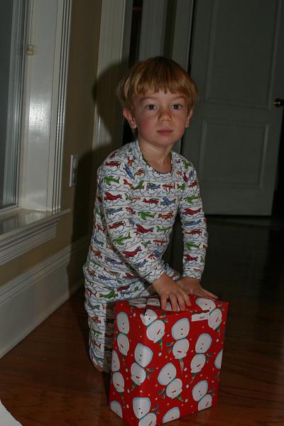 Monkey Boy opens his presents.
