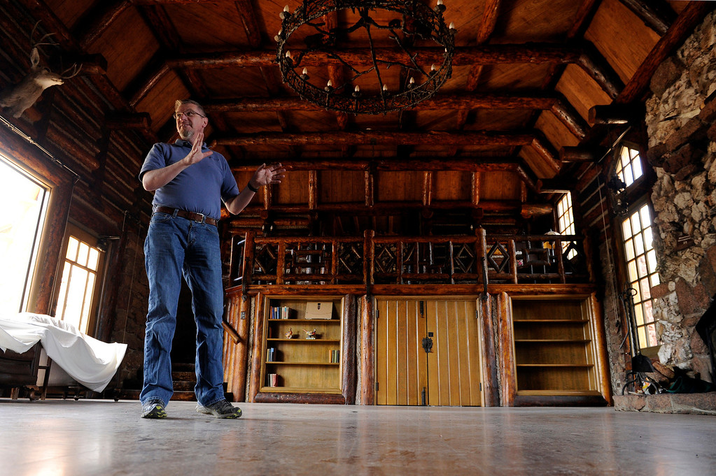 . PINE, CO - APRIL 18: Andy Spencer, a museum education coordinator with Jefferson County Open Space, points out original features at Baehrden Lodge, on April 18, 2014, in Pine, Colorado. The lodge was built in 1927 to serve as a summer home for William A. Baehr -- a Chicago utilities magnate -- and his family. In 1986, Jefferson County Open Space acquired the property and slowly been renovating it ever since. Visitors can tour the property on Sundays, starting in June. (Photo by Anya Semenoff/The Denver Post)