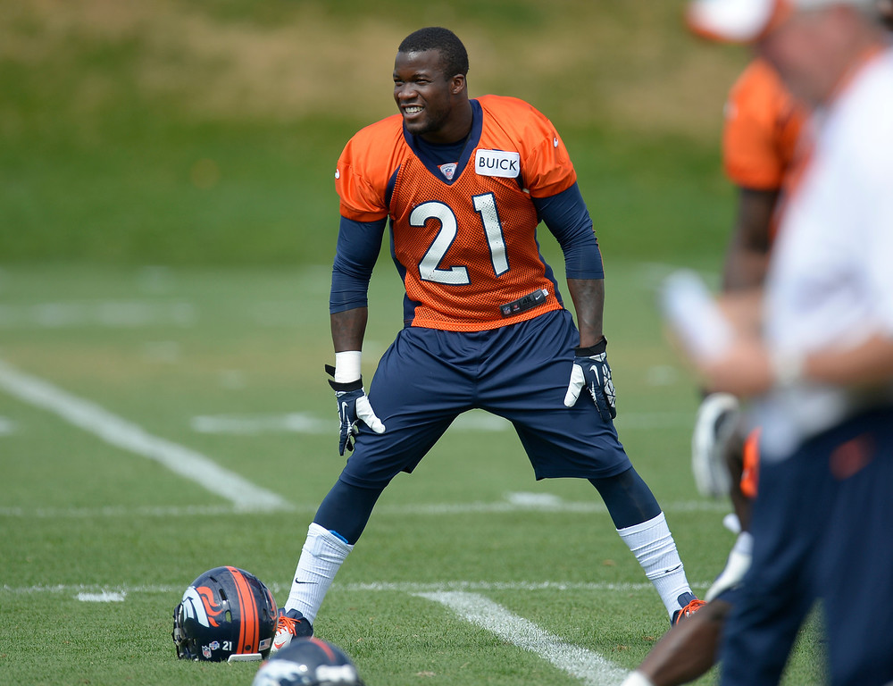 . Denver Broncos running back Ronnie Hillman (21) stretches during practice August 23, 2013 at Dove Valley (Photo by John Leyba/The Denver Post)