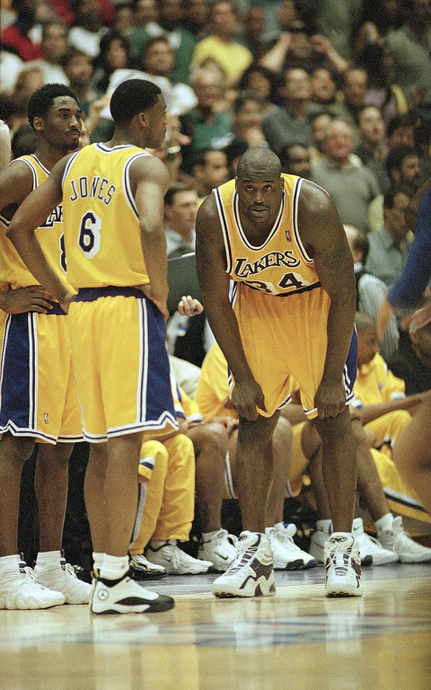 . Los Angeles Lakers? Shaquille O?Neal (34) Eddie Jones (6) and Kobe Bryant look dejected during a timeout late in the fourth quarter of their Western Conference finals playoff game against the Utah Jazz? on Sunday, May 24, 1998 in Inglewood, California. The Lakers were swept by the Jazz, 94-92. (AP Photo/Kevork Djansezian)