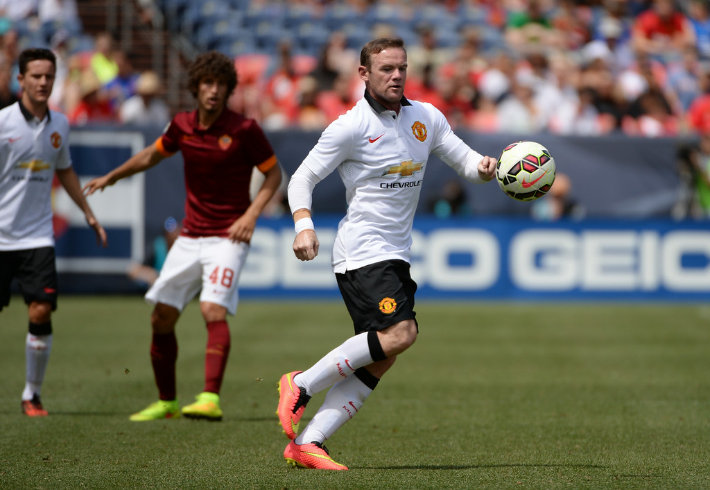 . Wayne Rooney of Manchester United (10), front, controls the ball against  Arturo Calabresi of AS Roma (91) during the game at Sports Authority Field at Mile High in Denver, Colorado,  July 26, 2014. (Photo by Hyoung Chang/The Denver Post)