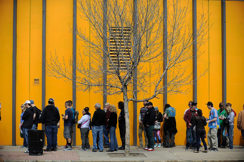 . A line of marijuana enthusiasts wraps around the block as they wait to get in during the final day of the first ever High Times US Cannabis Cup at the Exdo Center in Denver on Sunday, April 21, 2013. Seth A. McConnell, The Denver Post