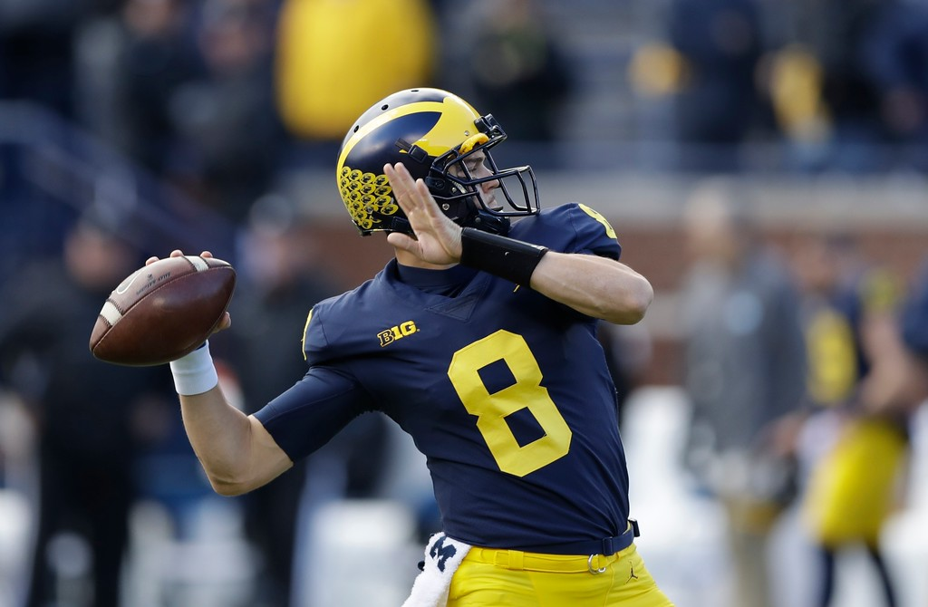 . Michigan quarterback John O\'Korn throws during warmups before an NCAA college football game against Ohio State, Saturday, Nov. 25, 2017, in Ann Arbor, Mich. (AP Photo/Carlos Osorio)