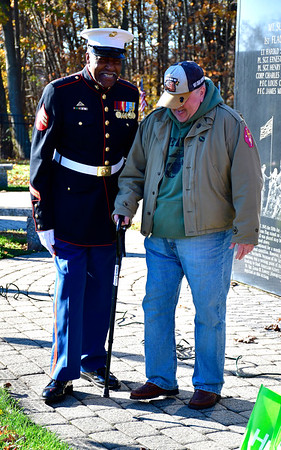 11/2/2019 Mike Orazzi | StaffrLeRoy Pittman Jr. talks with John Callahan during the Marine Corps 244th birthday celebration at the National Iwo Jima Memorial in New Britain Saturday morning.