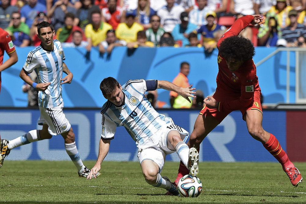 . Argentina\'s forward and captain Lionel Messi (C) vies with Belgium\'s midfielder Marouane Fellaini during a quarter-final football match between Argentina and Belgium at the Mane Garrincha National Stadium in Brasilia during the 2014 FIFA World Cup on July 5, 2014. (JUAN MABROMATA/AFP/Getty Images)