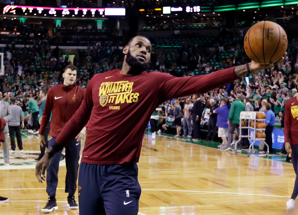 . Cleveland Cavaliers forward LeBron James grabs a rebound as he warms up before Game 5 of the team\'s NBA basketball Eastern Conference finals against the Boston Celtics, Wednesday, May 23, 2018, in Boston. (AP Photo/Charles Krupa)