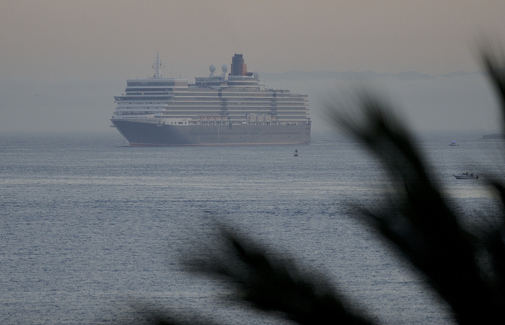 . LONG BEACH, CALIF. USA -- The youngest Cunard Line ship, Queen Elizabeth, enters Long Beach (Calif.) Harbor on route to visit the Queen Mary on March 12, 2013. The Queen Mary was built by Cunard in 1936 and retired in 1967. The Queen Mary, now a permanently berthed, is a hotel and special events venue. The two ships exchanged whistle blows.   Photo by Jeff Gritchen / Los Angeles Newspaper Group