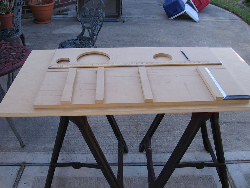 Next you prepare each of the four side panels by marking the locations for four braces. The exact location of each brace isn't critical, but they should be set at unequal distances from each other, and they should be installed perpendicular to the side panel with the ends aligned perfectly with the edges of the panels.