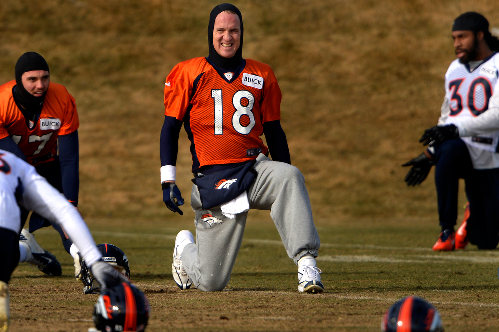 . Quarterback Peyton Manning #18 of the Denver Broncos stretching before practice at Dove Valley in Centennial January 10, 2014 Centennial, Colorado. (Photo by Joe Amon/The Denver Post)