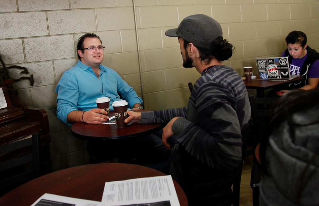 . Manager Nick Taptelis, left, talks with employee Kyle Patrick at Philz\' Coffee in San Jose Saturday, March 9, 2013. San Jose�s minimum wage goes into effect Mon. Mar. 11. Businesses who fought the measure are now trying to make lemons out of lemonade by trying to promote San Jose businesses as more ethical and encouraging a buy-local campaign.  (Patrick Tehan/Staff)