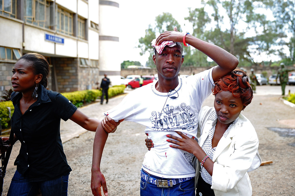 . A Kenyan man holds his bleeding head helped by two women after clashes with riot police on May 20, 2014 in Nairobi. Over 100 people were arrested in the Kenyan capital on May 20, police said, as student protests over a fee increase descended into running battles with riot police. The demonstrations were largely peaceful in the morning but quickly turned violent as the huge crowd of students from various universities disrupted traffic and robbed several motorists. John Muchucha/AFP/Getty Images