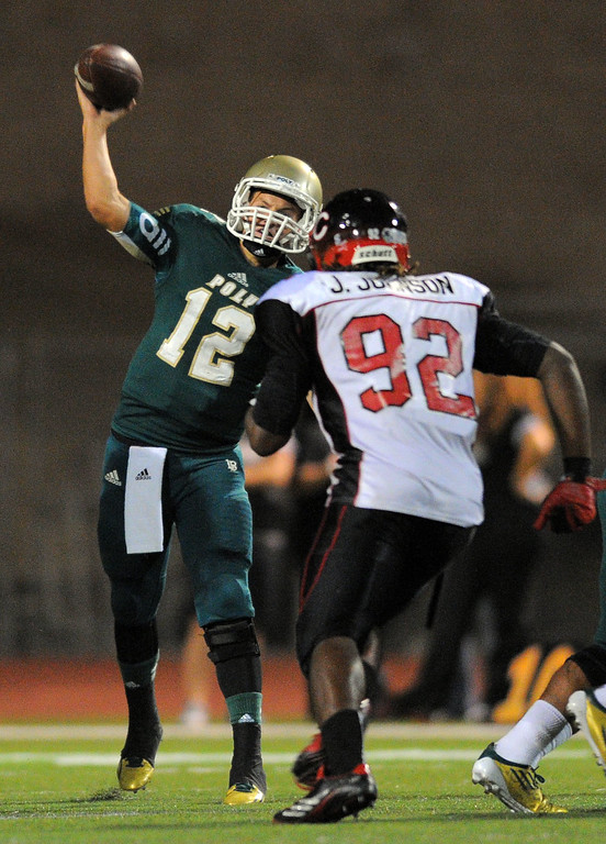 . Long Beach Poly football takes on Centennial (Corona) as part of the Mission Viejo Classic in Mission Viejo, CA on Friday, September 13, 2013. Under pressure from Centennial\'s Jaylen Johnson, Poly QB Josh Love fires a pass. (Photo by Scott Varley, Press-Telegram)