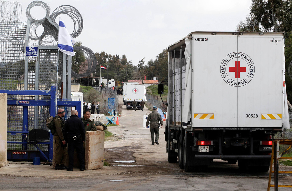 . A Red Cross truck loaded with apples makes its way across the Kuneitra border crossing between Israel and Syria March 5, 2013. Starting Tuesday about 18,000 tons of apples grown by farmers in the Golan Heights will be transferred across the border to Syria and marketed there, as part of a project initiated by the Israeli Ministry of Agriculture and Rural Development. Israel captured the Golan Heights in the 1967 Middle East war and annexed it in 1981 in a move not recognized internationally. REUTERS/Baz Ratner