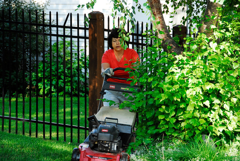 2011/7/27 – My good wife mowing the lawn as I leave for work. I've mowed about three times so far this year. She has done it the rest of the time. I owe her big time for taking on a chore that is traditionally done by the man of the house.