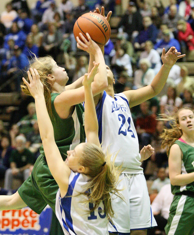 . Hamilton\'s Jessica Welsh (3) goes up for the shot as Ft Edwards  players defends in the second half of the NYSPHSAA Class D semifinal in Troy on Saturday, March 15, 2014.JOHN HAEGER-ONEIDA DAILY DISPATCH @ONEIDAPHOTO ON TWITTER