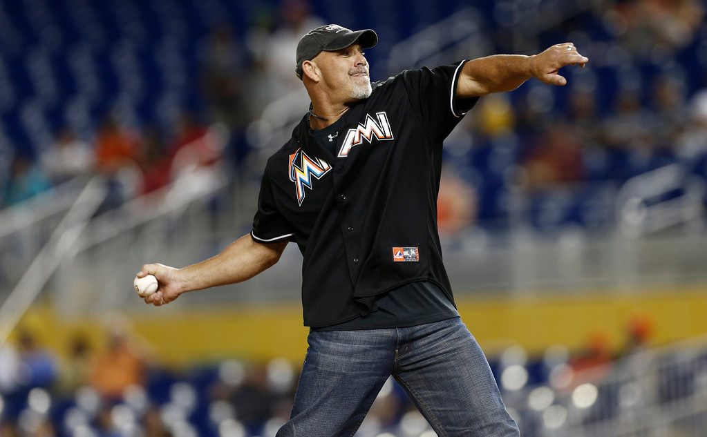 . Professional wrestler Bill Goldberg throws out the first pitch before a baseball game between the Colorado Rockies and Miami Marlins, Saturday, Aug. 24, 2013, in Miami. (AP Photo/J Pat Carter)