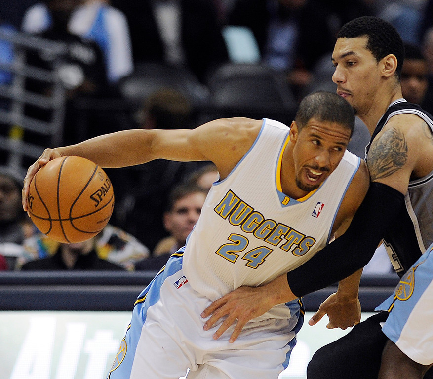 . Andre Miller #24 of the Denver Nuggets drives against Danny Green #4 of the San Antonio Spurs after a pick by JJ Hickson #7 of the Denver Nuggets during an NBA game at the Pepsi Center on November 5, 2013, in Denver, Colorado. (Photo by Daniel Petty/The Denver Post)