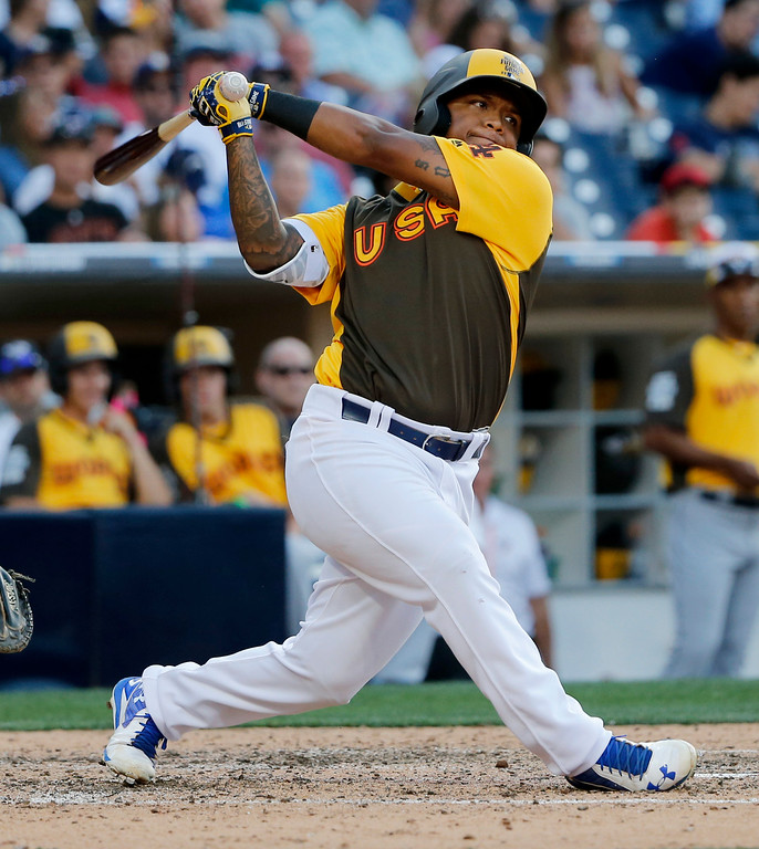 . U.S. Team\'s Willie Calhoun, of the Los Angeles Dodgers, this against the World Team during the eighth inning of the All-Star Futures baseball game, Sunday, July 10, 2016, in San Diego. (AP Photo/Lenny Ignelzi)