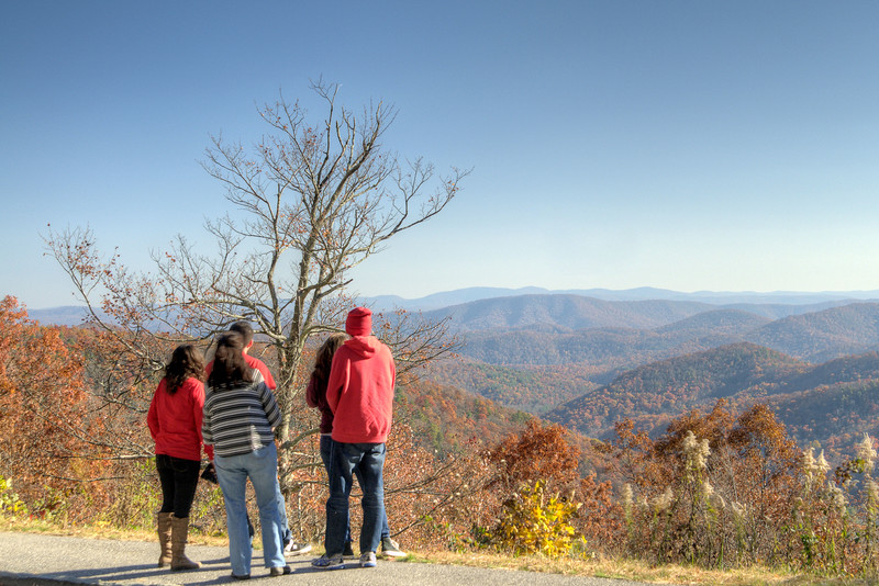 A group of people enjoy the view of fall colors near Milepost 409 on the Blue Ridge Parkway in North Carolina on Sunday, November 3, 2013. Copyright 2013 Jason Barnette