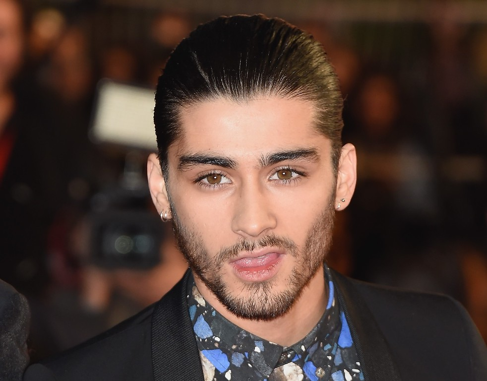 """. One Direction member Zayn Malik attends the NRJ Music Awards at Palais des Festivals on December 13, 2014 in Cannes, France.  The chart-topping boy band \""""One Direction\"""" says Zayn Malik has left the group.  (Photo by Pascal Le Segretain/Getty Images)"""