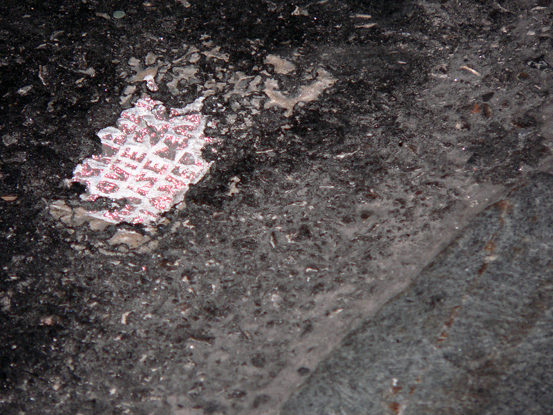 Tile with sparkle paint message. Chestnut Street Philadelphia, 2005.