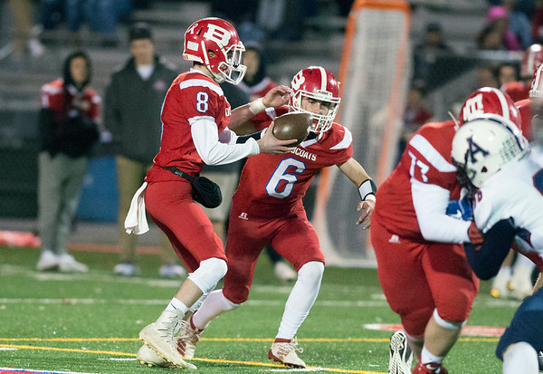 11/01/19 Wesley Bunnell | StaffrrBerlin football vs Avon on Friday night at Sage Park. Justn Skates (8) hands off to Johnny McGeever (6).