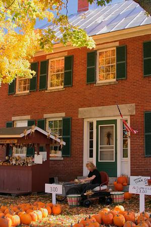 Brick Farm House Selling Pumpkins