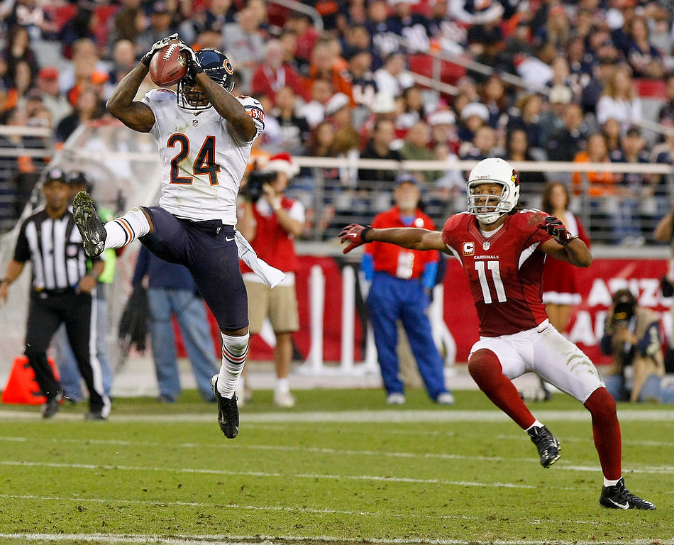 . Chicago Bears cornerback Kelvin Hayden (24) makes the interception in front of Arizona Cardinals wide receiver Larry Fitzgerald (11) during the second half of an NFL football game, Sunday, Dec. 23, 2012 in Glendale, Ariz. (AP Photo/Rick Scuteri)