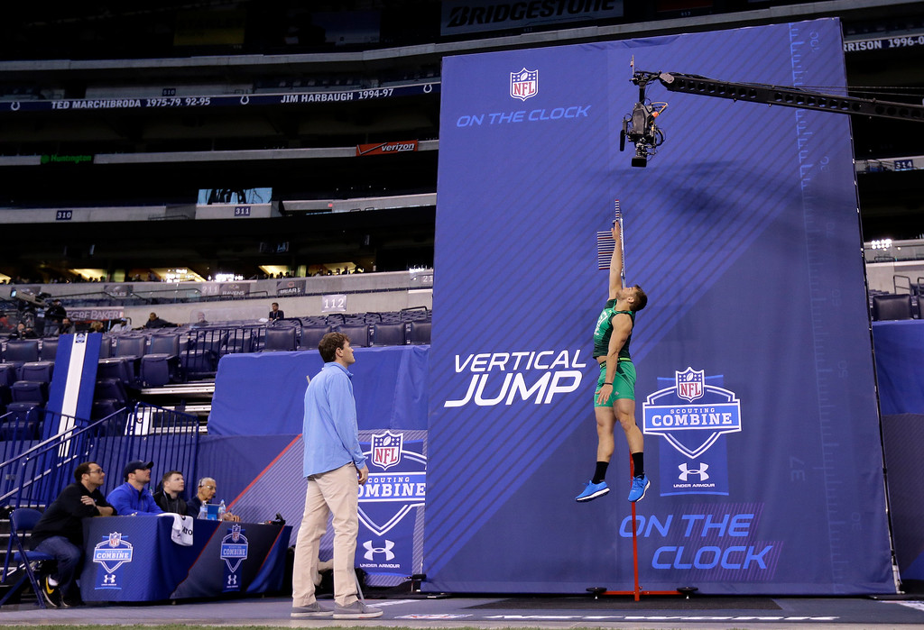 . Tennessee-Chattanooga defensive lineman Davis Tull runs a drill at the NFL football scouting combine in Indianapolis, Sunday, Feb. 22, 2015. (AP Photo/Julio Cortez)