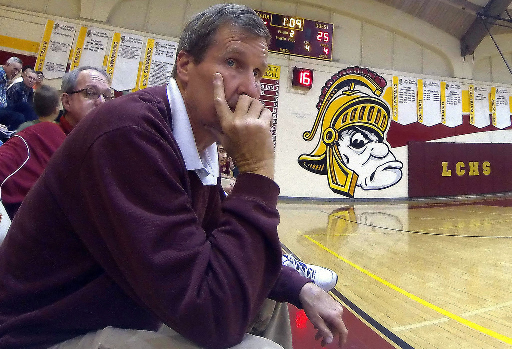 . La Canada head coach Tom Hofman looks down court in the second quarter as he would win his 600th game after defeating La Salle 73-62 during a prep basketball game at La Canada High School in La Canada, Calif., on Friday, Jan. 10, 2014. Hofman record is 600 wins and 186 losses since becoming varsity head coach in the 1986-87 season. (Keith Birmingham Pasadena Star-News)