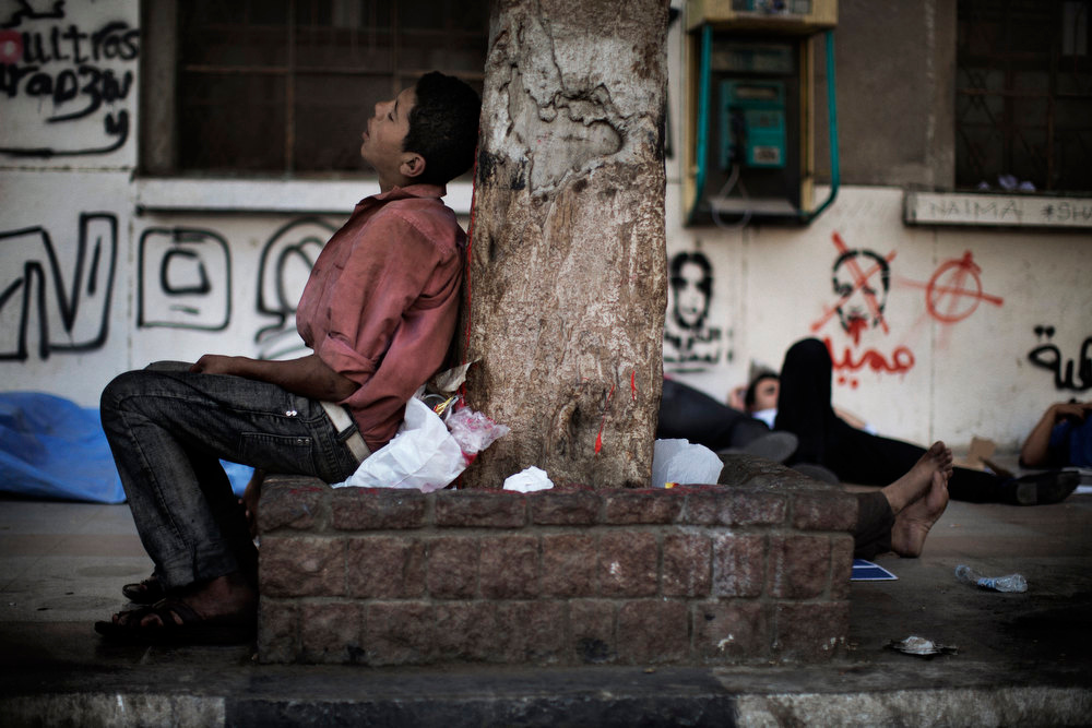 Description of . An Egyptian youth sleeps in Cairo's landmark Tahrir Square on June 3, 2012 after a night of protests. Hundreds of demonstrators are occupying Tahrir Square after a court sentenced ousted president Hosni Mubarak and his interior minister Habib al-Adly to life in prison but acquitted six security chiefs in the deaths of protesters last year. MARCO LONGARI/AFP/Getty Images