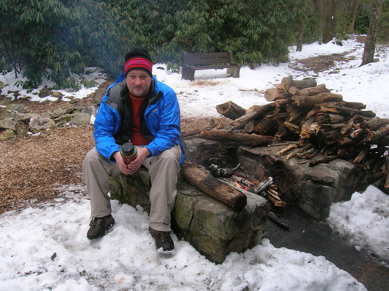 Tim relaxing by the fire after a long, hard hike.