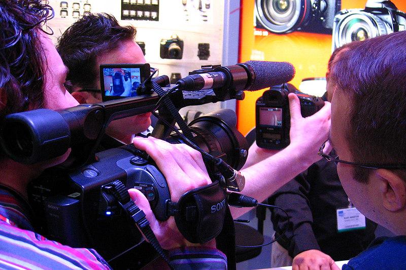 TV crew examining the Canon EOS-1D Mark III.