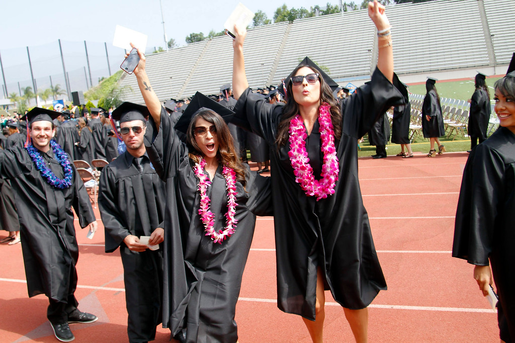 . Jubilant graduates during the Citrus College 97th Commencement Ceremony, at Citrus College Stadium, in Glendora, Saturday, June 15, 2013. (Correspondent Photo by James Carbone/SVCITY)