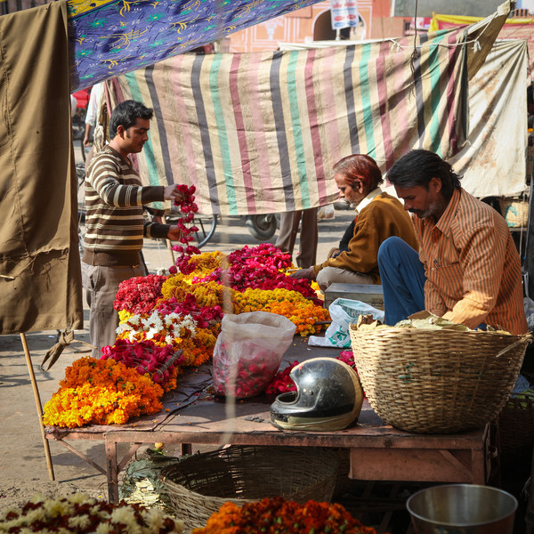 Our auto-rickshaw driver buying some flowers.