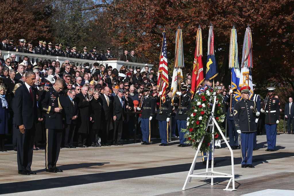 . U.S. President Barack Obama (L) looks on after positionsing a commemorative wreath during a ceremony on Veterans Day at the Tomb of the Unknowns at Arlington National Cemetery on November 11, 2013 in Arlington, Virginia. For Veterans Day, President Obama is paying tribute to military veterans past and present who have served and sacrificed their lives for their country.  (Photo by Mark Wilson/Getty Images)