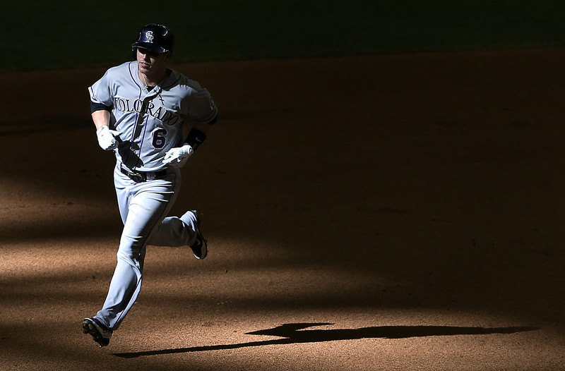 . Corey Dickerson #6 of the Colorado Rockies rounds the bases after hitting a solo home-run against the Arizona Diamondbacks during the tenth inning of the MLB game at Chase Field on August 10, 2014 in Phoenix, Arizona.  The Rockies defeated the Diamondbacks 5-3 in 10 innings.  (Photo by Christian Petersen/Getty Images)