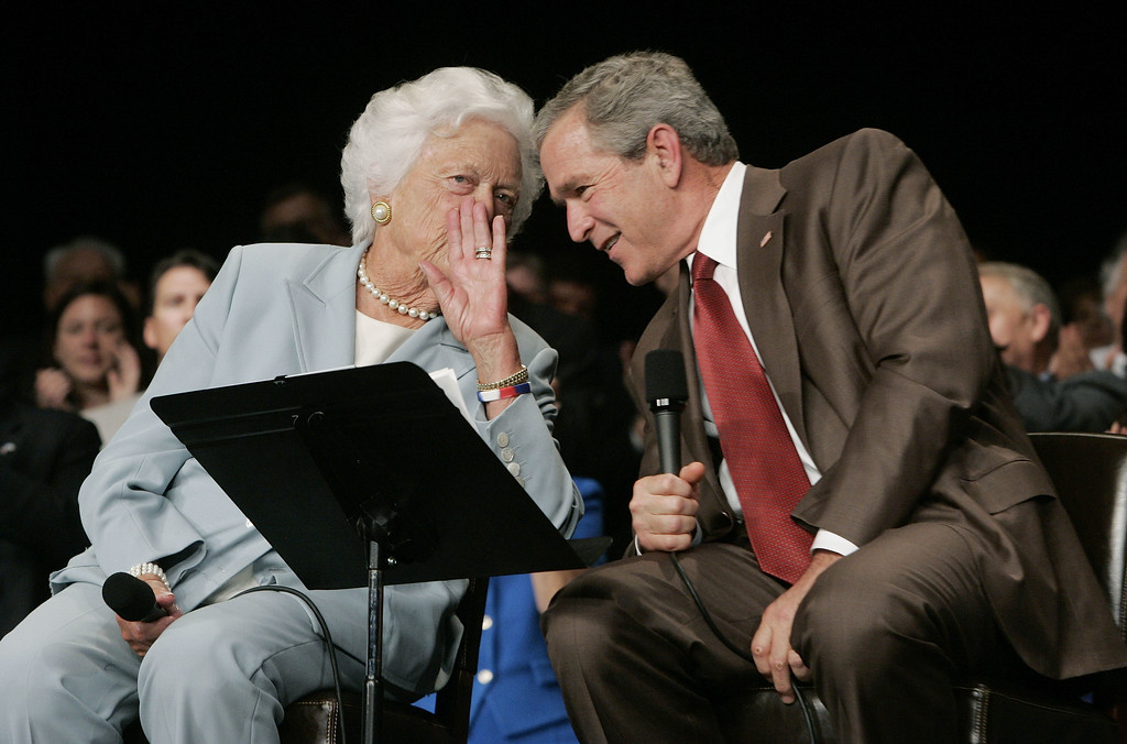 """. President Bush, right, leans over to listen to his mother Barbara Bush as he holds a discussion on \""""Senior Security\"""" at the Boisfeuillet Jones Atlanta Civic Center in Atlanta, Ga., Friday, July 22, 2005.   (AP Photo/Charles Dharapak)"""