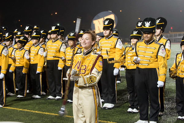 11/02/18 Wesley Bunnell   Staff New Britain football vs East Hartford at Veterans Stadium on Friday night. The band Drum Major spins the mace during their halftime presentation.