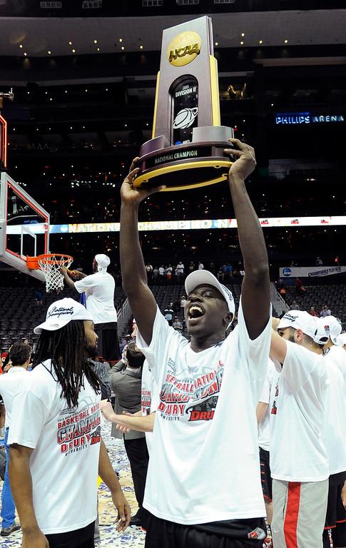 . Drurys\' Cameron Adams celebrates after playing Metro State during the NCAA Division ll national championship basketball game Sunday, April 7, 2013, in Atlanta. Drury won 74-73. (AP Photo/John Amis)