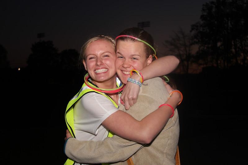 Photo by Tessa Walsh Carol Zangla and Mackenzie Ropka volunteered directing runners to the next turn.